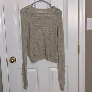 Cropped beige sweater with jewel details